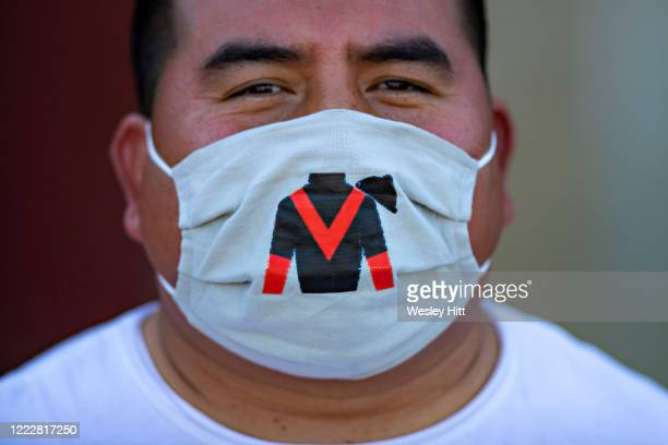 Groomer wears a mask in the paddock area during the Covid19 Pandemic on Derby Day at Oaklawn Racing Casino Resort on May 2 2020 in Hot Springs...