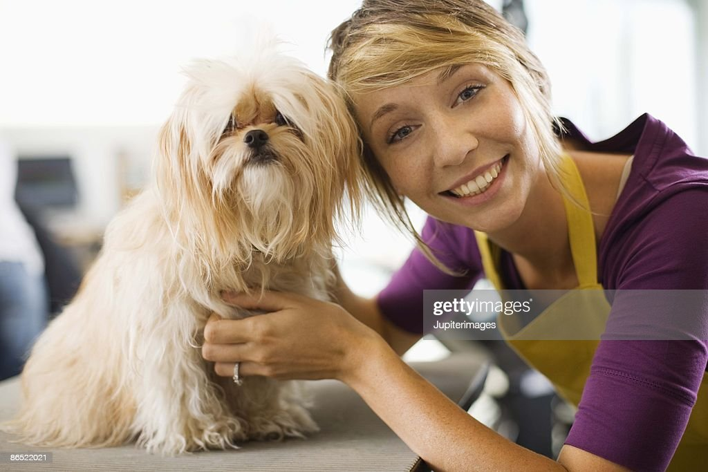 Groomer with a dog : Stock Photo