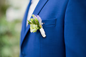 grooms boutonniere with white flowers