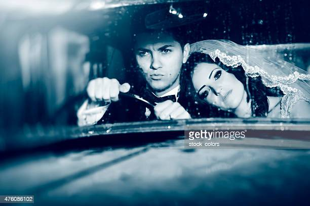 grooms inside car in rainy day