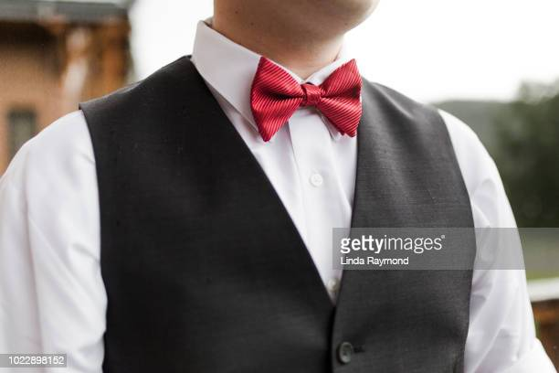 grooms red bow tie - bow tie stock pictures, royalty-free photos & images