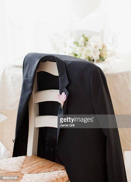 grooms suit jacket on chair at wedding, studio shot - coat stock pictures, royalty-free photos & images