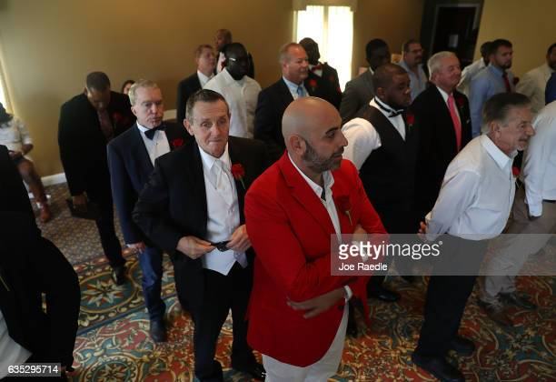 Grooms wait to participate in a group Valentine's day wedding ceremony at the National Croquet Center on February 14 2017 in West Palm Beach Florida...