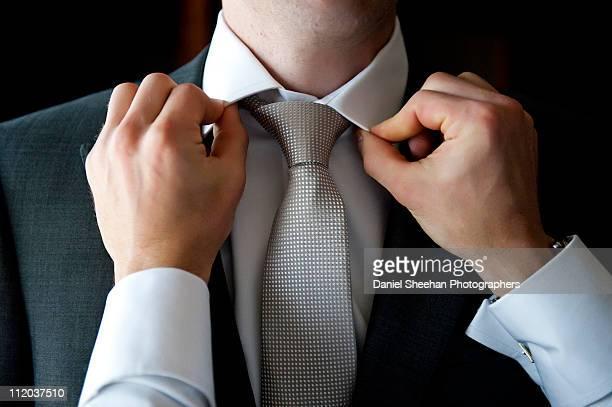 Groomsman Fixing Grooms Tie