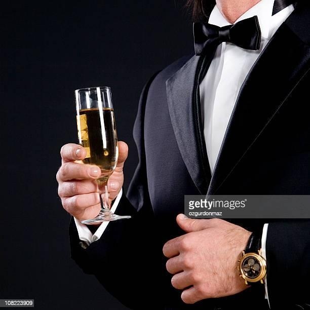 Groomsman holding champagne