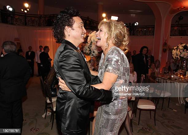 Groomsman Paul Stanley and Bride Shannon Tweed attend the wedding of Gene Simmons and Shannon Tweed at the Beverly Hills Hotel on October 1 2011 in...