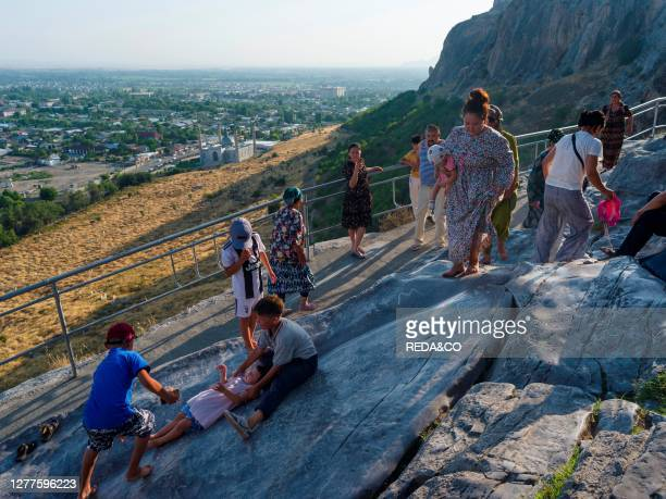 Groove of Wishes. Sliding down is part of popular belief. Mount Suleiman-Too . A UNESCO World Heritage site. City Osh in the Fergana Valley close to...