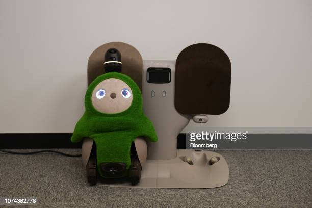 A Groove X Inc Lovot Edamame home robot stands at a charging station at the company's office in Tokyo Japan on Tuesday Dec 11 2018 The Lovot is meant...