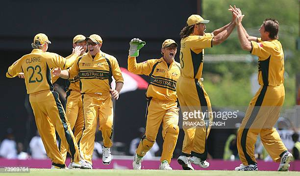 Australian bowler Glenn McGrath Andrew Symonds Adam Gilchrist Matthew Hayden Ricky Ponting and Michael Clarke celebrate the wicket of South Africa's...