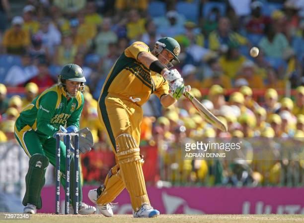 Australian cricketer Matthew Hayden plays a shot as South African wicketkeeper Mark Boucher looks on during the ICC Cricket World Cup 2007 semifinal...