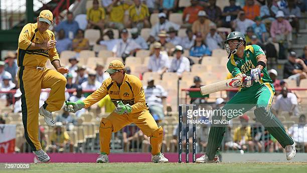 Australia's cricket captain Ricky Ponting jumps as Adam Gilchrist catches the ball missed by South African batsman Justin Kemp during a semifinal of...