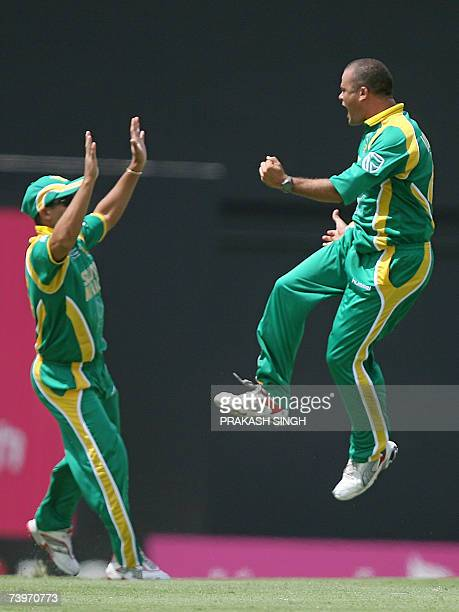 South African cricketer Charl Langeveldt celebrates after dismissing Australia's Adam Gilchrist during an ICC Cricket World Cup 2007 semifinal at...