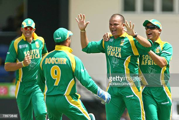 South African cricketer Charl Langeveldt celebrates with teammates after taking the opening wicket of Australia's Adam Gilchrist during the ICC...