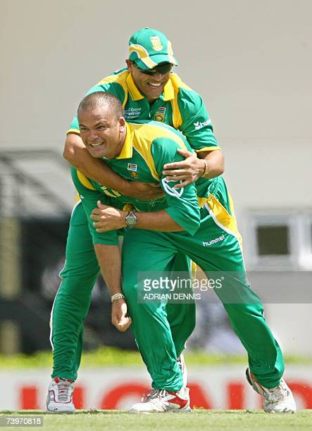 South Africa's Ashwell Prince hugs Charl Langeveldt after taking the opening wicket of Australia's Adam Gilchrist during the ICC Cricket World Cup...