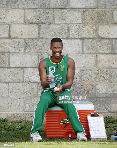 Gros Islet, SAINT LUCIA: South Africa's Makhaya Ntini laughs at a teammate while taking a break from bowling in the nets during training at...