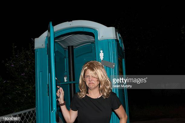 grossed out by the porta potty - portable toilet stock photos and pictures