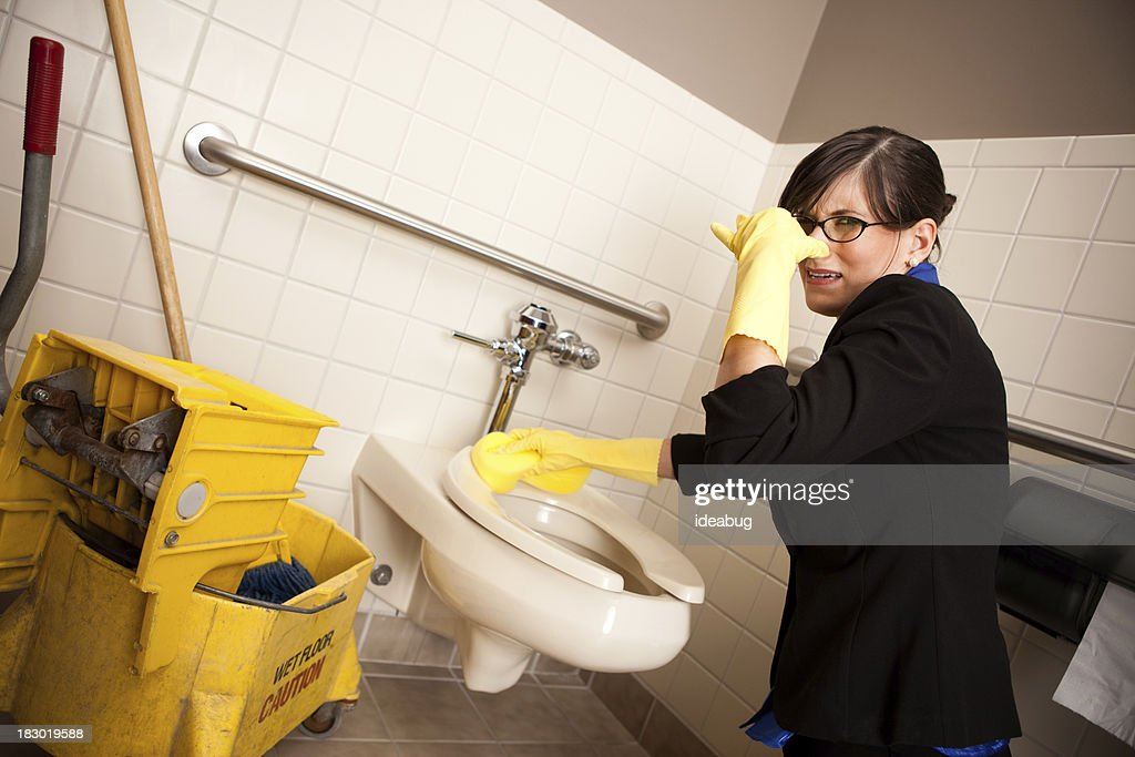 Grossed-Out Business Woman Cleaning the Restroom Toilet : Stock Photo