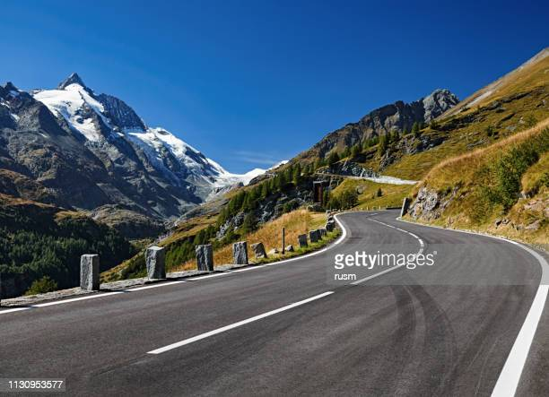 grossglockner mountain and scenic high alpine road, austria - mountain road stock pictures, royalty-free photos & images