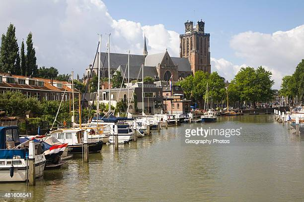 Grote Kerk cathedral church and boats in Nieuwe Haven Dordrecht Netherlands