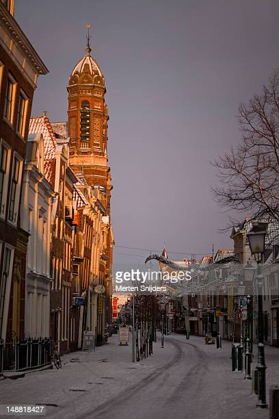 grote noord during winter with the entrance towers of the koepelkerk on left. - merten snijders stock pictures, royalty-free photos & images