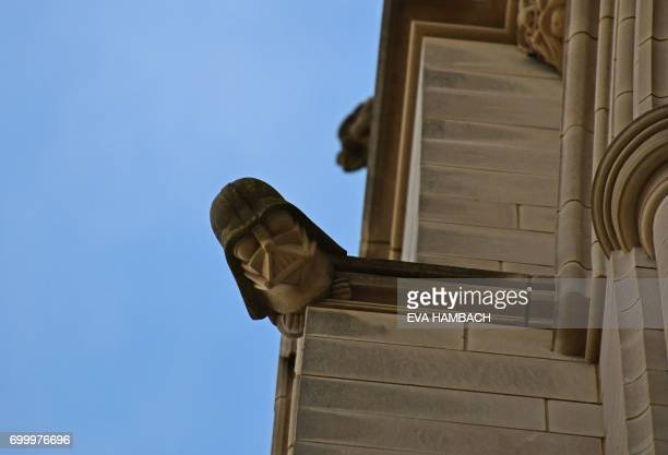 A grotesque in the shape of Darth Vader is seen atop the north side of the National Cathedral in Washington DC June 20 2017 There are 112 gargoyles...