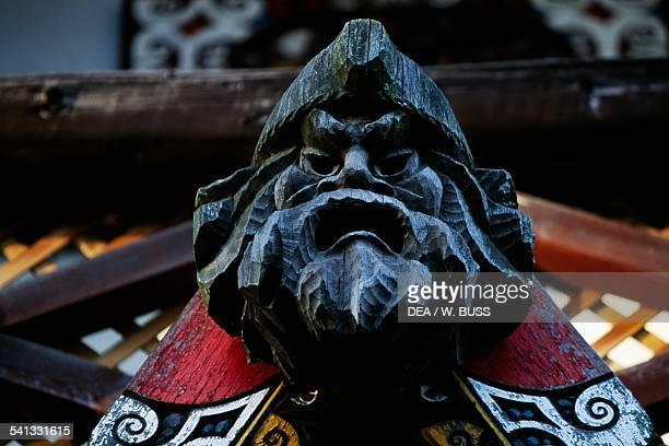 Grotesque mask architectural detail Ainu Kotan village Akan national park Hokkaido Japan