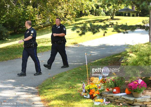 Groton Police officers return to the home right rear where Orion Krause allegedly killed his mother a caretaker and his grandparents the previous...