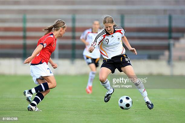 Grotta Astrid Ree of Norway and Marie Pollmann of Germany fight for the ball during the Women's U19 European Championship match between Germany and...