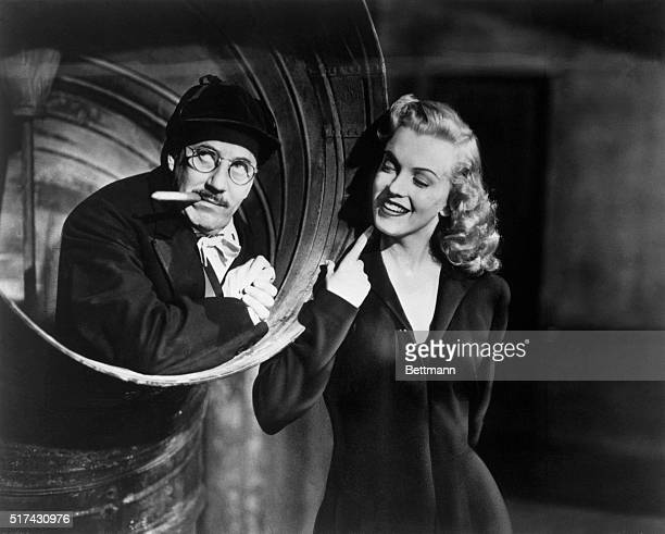 Groucho Marx and Actress Marilyn Monroe in a scene from movie Love Happy 1949