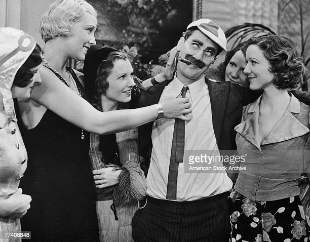 Groucho Marx as Doctor Hugo Z Hackenbush basks in the attentions of a group of young women in a scene from the Marx Brothers comedy 'A Day at the...