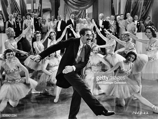 Groucho Marx dances with the Corps de Ballet in a scene from the film Duck Soup