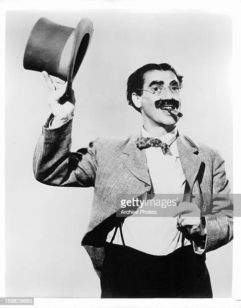 Groucho Marx tips his hat in publicity portrait for the film 'Room Service' 1938
