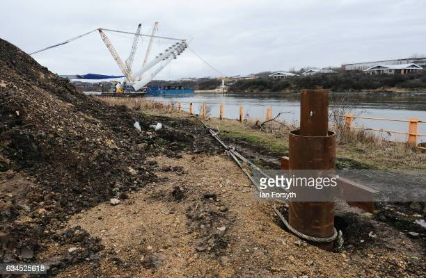 A ground anchor helps to secure the barge in the river as the final 100 metre centrepiece of Sunderland's new River Wear crossing is lifted into...