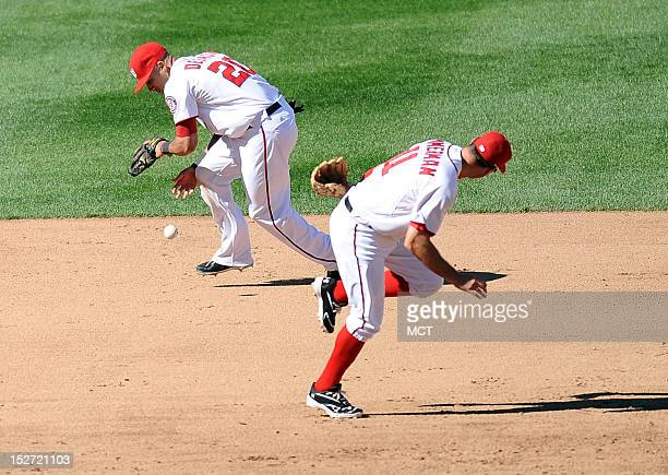 A ground ball hit by Milwaukee Brewers left fielder Ryan Braun finds its way past Washington Nationals third baseman Ryan Zimmerman and Nationals...
