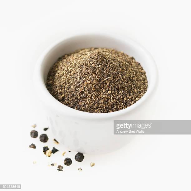 Ground black pepper in a ceramic pot