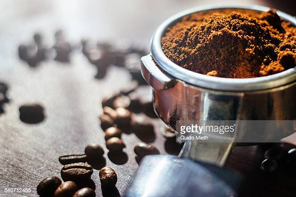 ground coffee and beans. - ground coffee stock photos and pictures