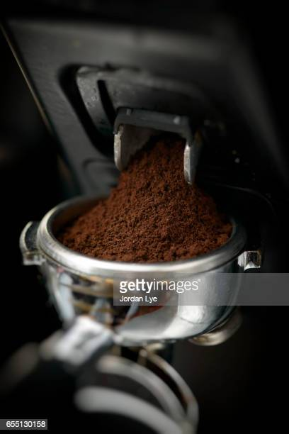 ground coffee bean - ground coffee stock photos and pictures