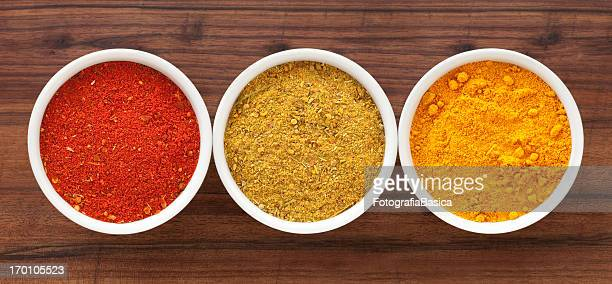 ground condiments - curry powder stock photos and pictures