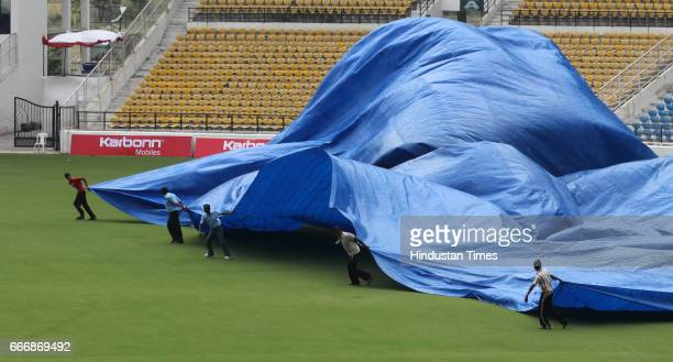 Ground covers fly high while groundsmen rush to cover the wicket as strong wind and heavy rain stormed the VCA ground and forced Indian team to call...