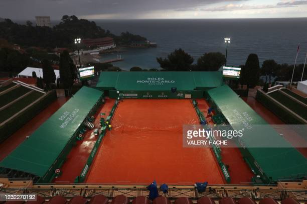 Ground covers protects the court surface as play is suspended due to rain late on day two of the Monte-Carlo ATP 1000 Masters Series tennis...
