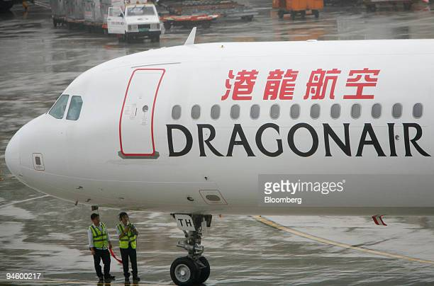Ground crew attend to a Dragonair jet at the Pudong International Airport in Shanghai China Wednesday June 7 2006 Cathay Pacific Airways Ltd Asia's...