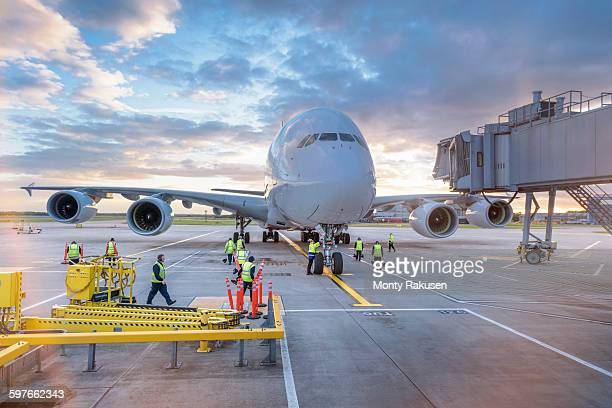 Ground crew attending to A380 aircraft at airport