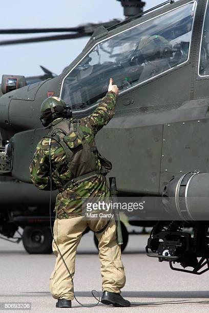 Ground crew from the Army Air Corps help land a Apache attack helicopter during a predeployment training exercise at RAF Lyneham on April 16 2008 in...