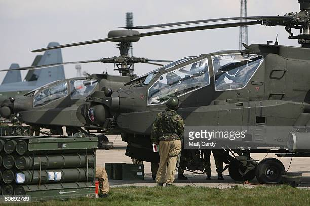 Ground crew from the Army Air Corps prepare a Apache attack helicopter during a predeployment training exercise at RAF Lyneham on April 16 2008 in...