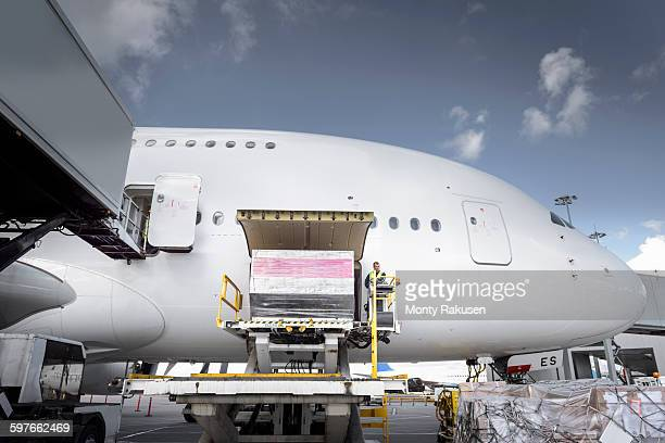 Ground crew loading freight into A380 aircraft