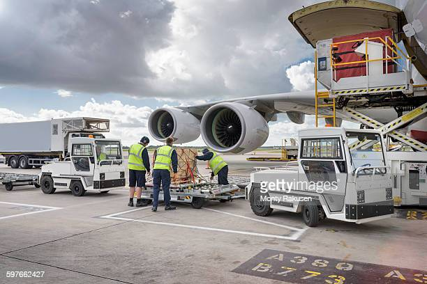 Ground crew loading freight onto A380 aircraft