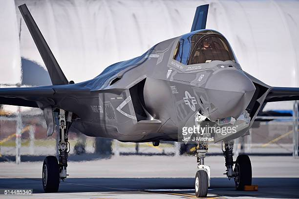 Ground crew manoeuvre the F35B Lightning II fifth generation multi role combat aircraft at Marine Corps Air Station Beaufort on March 8 2016 in...