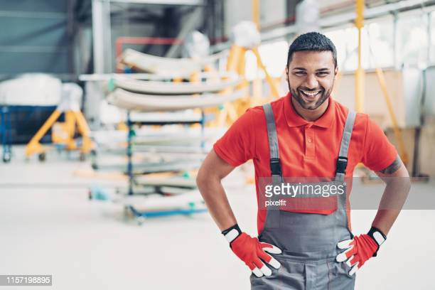 ground crew member in the hangar - arms akimbo stock pictures, royalty-free photos & images