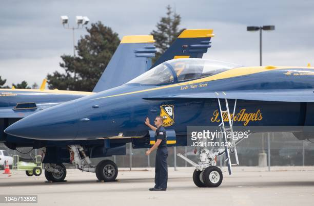 A ground crew member of the US Navy Blue Angels prepares a plane before a practice run for Fleet Week in Oakland California on October 04 2018