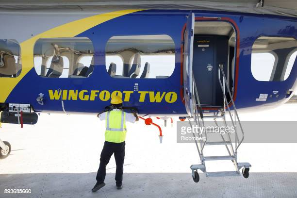 A ground crew member prepares the Goodyear Tire Rubber Co Wingfoot Two blimp after landing at the company's airship base in Carson California US on...